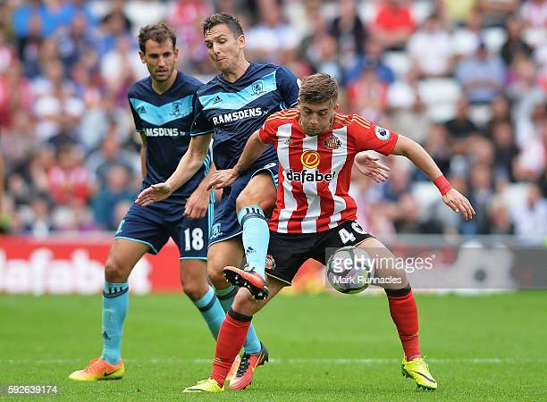Lynden Gooch of Sunderland is challenged by Stewart Downing of Middlesbrough during the Premier League match between Sunderland and Middlesbrough at...