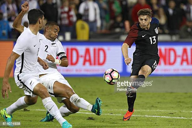 Lynden Gooch of United States shoots in front of Winston Reid of New Zealand in the second half during an International Friendly at RFK Stadium on...