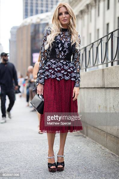 Lyndi Kennedy is seen wearing a black and white pattern blouse merlot skirt and black bag while attending Hood By Air during New York Fashion Week on...