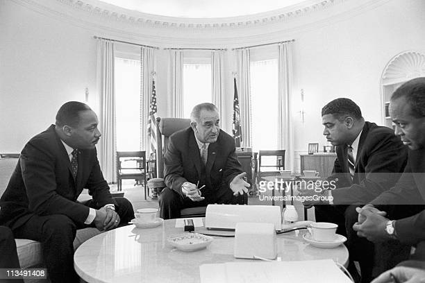 Lyndon Baines Johnson 36th President of the United States in talks with Civil Rights leaders in the White House including Martin Luther King Jr left