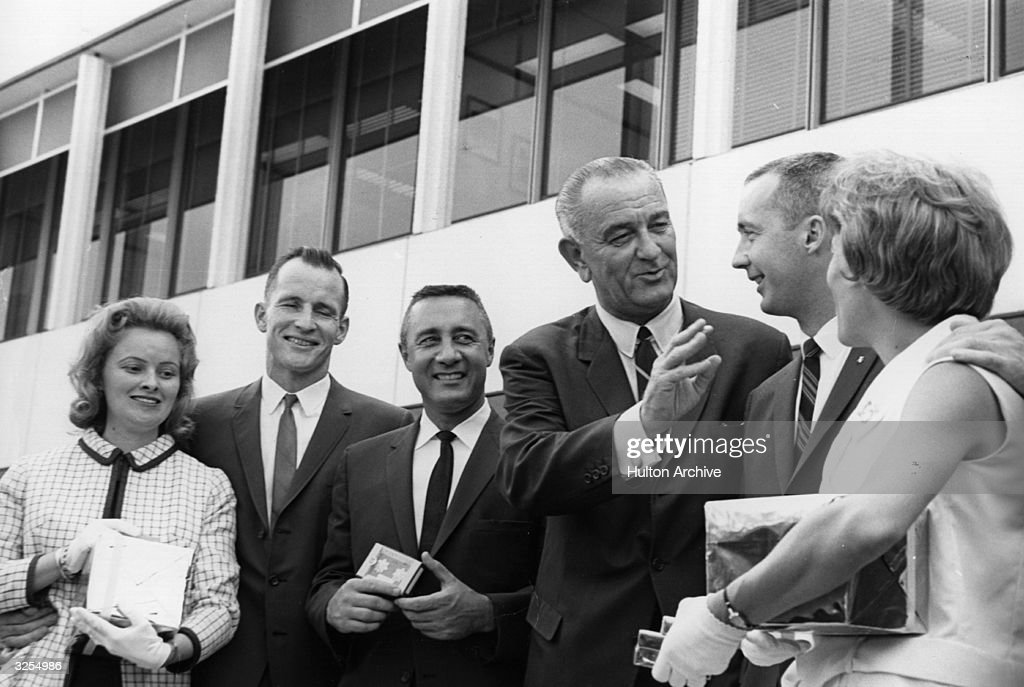 Lyndon Baines Johnson (1908 - 1973), 36th President of the United States, talking to James McDivitt, the Gemini 4 astronaut and his wife during a news conference at the NASA (National Aeronautics and Space Administration) Manned Spacecraft Centre. To his left are Mrs White and astronauts, Edward H White and Gus Grissom.