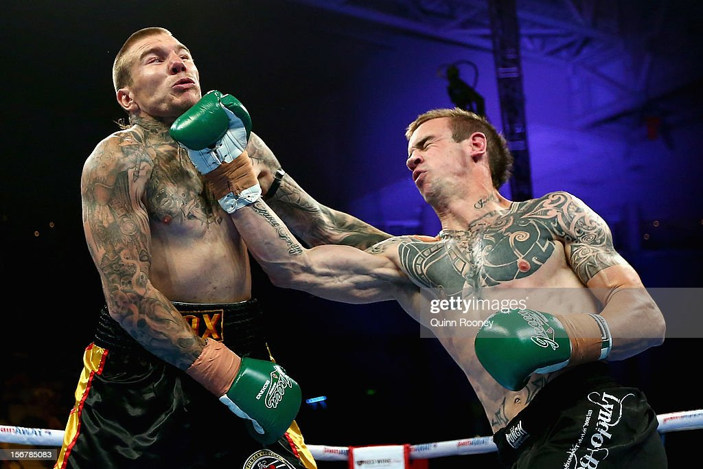 Lyndon Edney of Australia lands a punch to the chin of Jeremy Van Diemen of Australia in the undercard to the world title bout between Danny Green of Australia and Shane Cameron of New Zealand at Hisense Arena on November 21, 2012 in Melbourne, Australia.