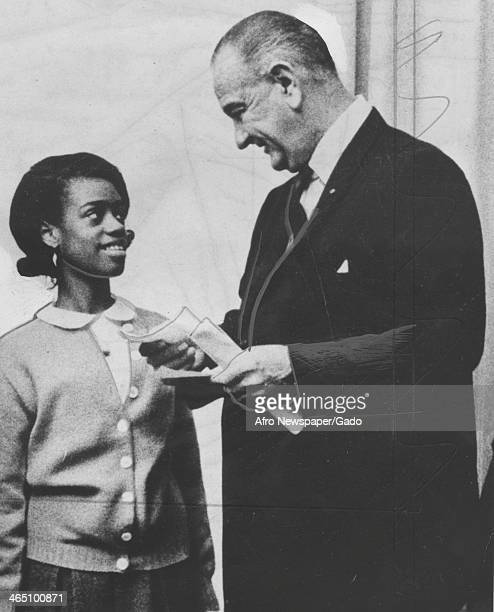 Lyndon Johnson meets with Linda Turnipseed a girl who was cured of cancer to launch the American Cancer Society's crusade April 15 1967