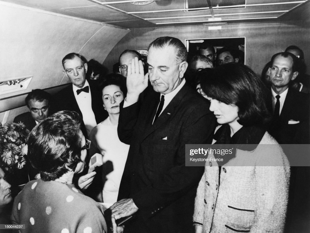 <a gi-track='captionPersonalityLinkClicked' href=/galleries/search?phrase=Lyndon+Johnson&family=editorial&specificpeople=91450 ng-click='$event.stopPropagation()'>Lyndon Johnson</a> (C) taking oath of office after President Kennedy's assassination aboard Air Force One, Former First Lady Jackie Kennedy (R), imminent First Lady Lady Bird (L), Jack Valenti, Congressmen Albert Thomas on november 22, 1963 in United States.