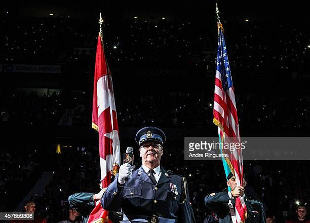 Lyndon Slewidge sings the national anthems in a coordinated tribute with NHL games in Montreal and Toronto to honor Canadian soldiers who lost their...