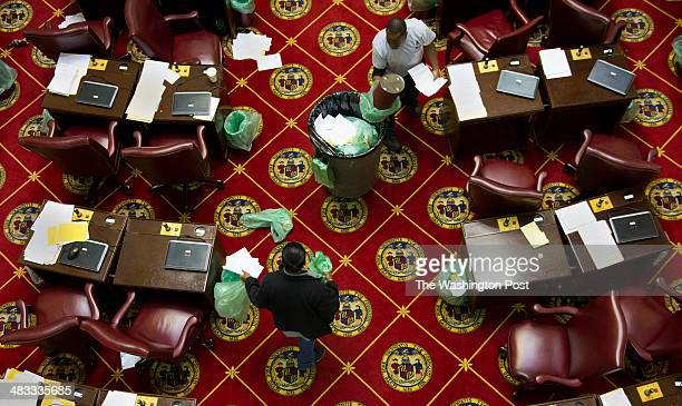 Lyndon Snowden and Makisha Thomas empty trash cans on the assembly floor during a lunch break on the last day of the Maryland Assembly in Annapolis...