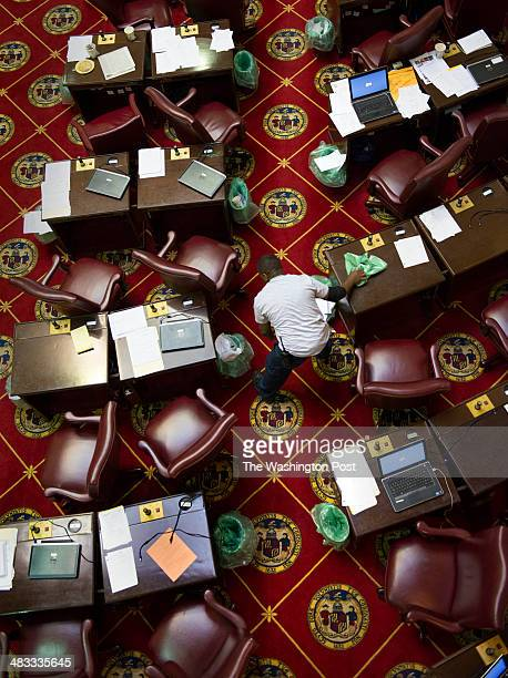 Lyndon Snowden empties trash cans on the assembly floor during a lunch break on the last day of the Maryland Assembly in Annapolis MD on April 2014...