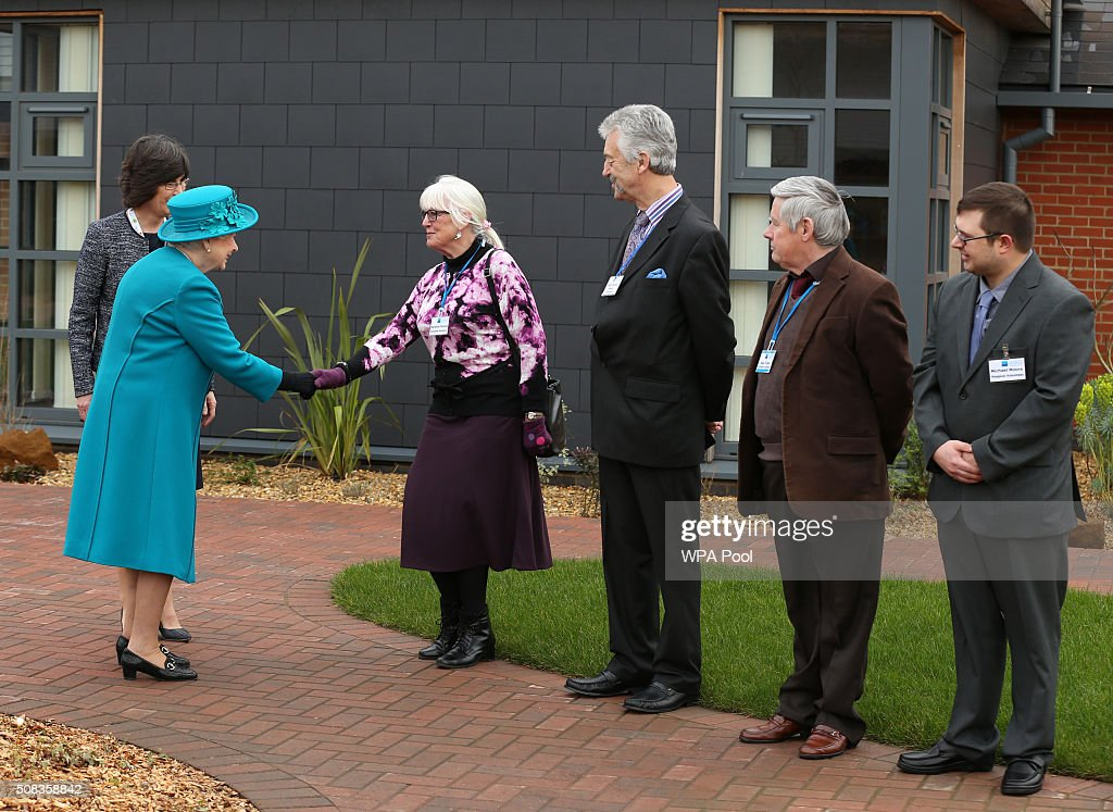 Lyndsay Carter (partially hidden) CEO of the Norfolk Hospice, introduces Queen Elizabeth II to volunteer gardeners (from third left) Marianne Charles, Paul Davey, Alan Twite and Michael Moore during her visit to The Norfolk Hospice at Hillington on February 4, 2016 near King's Lynn, England. The Queen met patients, trustees, volunteers and medical professionals working at the hospice, which has been serving its local community close to her Sandringham Estate for over 30 years.