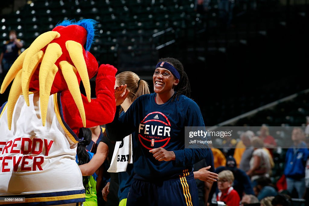 Lynetta Kizer #12 of Indiana Fever celebrates during a preseason game against the Dallas Wings on May 1, 2016 at Bankers Life Fieldhouse in Indianapolis, Indiana.
