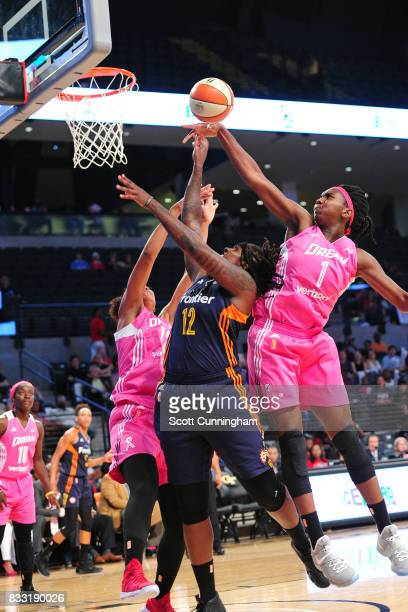 Lynetta Kizer of the Connecticut Sun shoots the ball against Elizabeth Williams of the Atlanta Dream during at WNBA game on August 15 2017 at Hank...