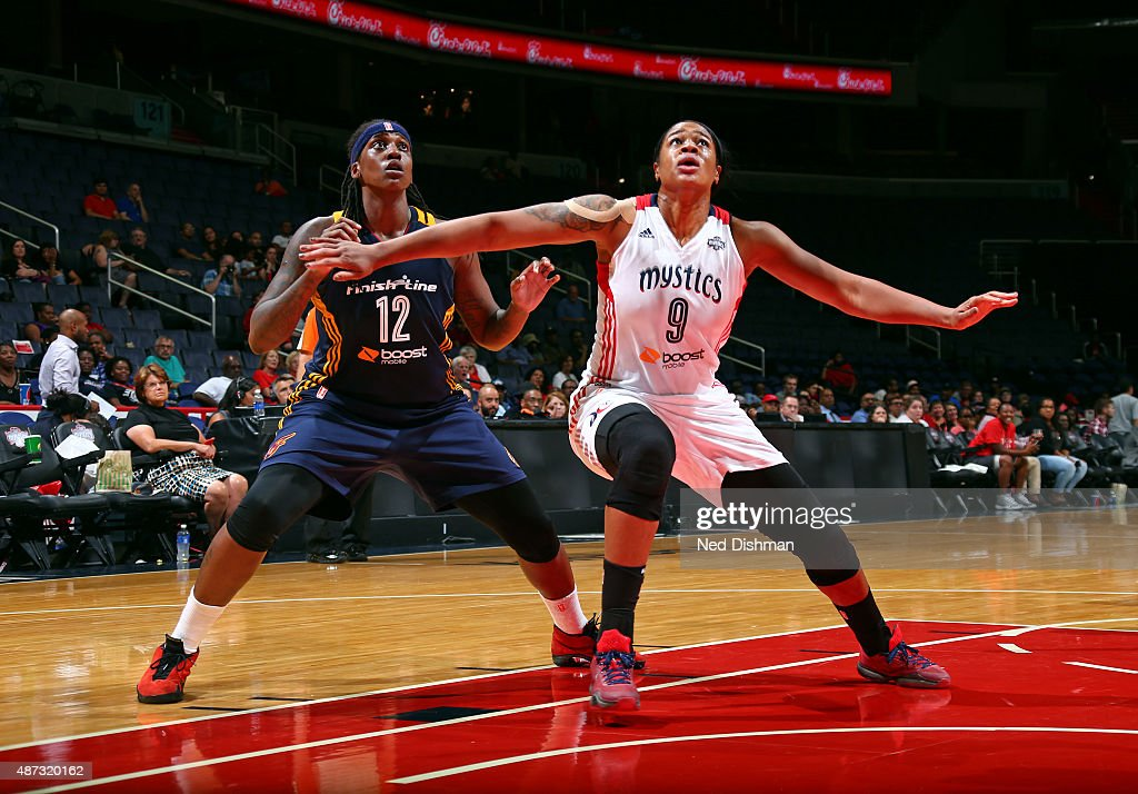 Lynetta Kizer #12 of the Indiana Fever boxes out <a gi-track='captionPersonalityLinkClicked' href=/galleries/search?phrase=Kia+Vaughn&family=editorial&specificpeople=4220876 ng-click='$event.stopPropagation()'>Kia Vaughn</a> #9 of the Washington Mystics on September 8, 2015 at the Verizon Center in Washington, DC.