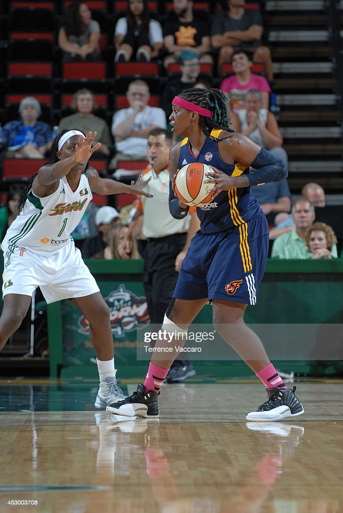 Lynetta Kizer #11 of the Indiana Fever controls the ball against the Seattle Storm on July 31,2014 at Key Arena in Seattle, Washington.
