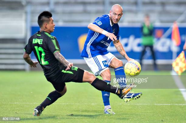 Lyngby BK's Michael Lumb passes the ball next to FC Krasnodar's Christian Ramirez during the UEFA Europa League third qualifying round second match...