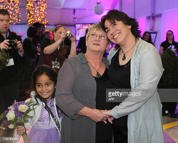 S Lynley Bendall and Ally Wanikau embrace with their sevenyearold daughter Maycee following their arrival in Auckland on August 19 2013 after making...