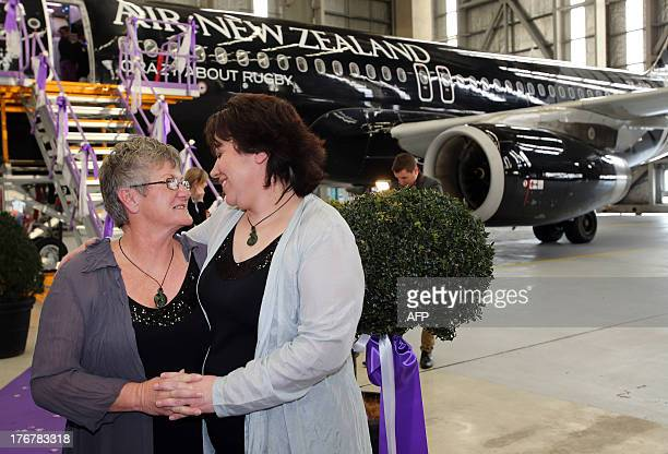 Lynley Bendall and Ally Wanikau look at one another upon their arrival in Auckland on August 19 2013 after making history celebrating the...