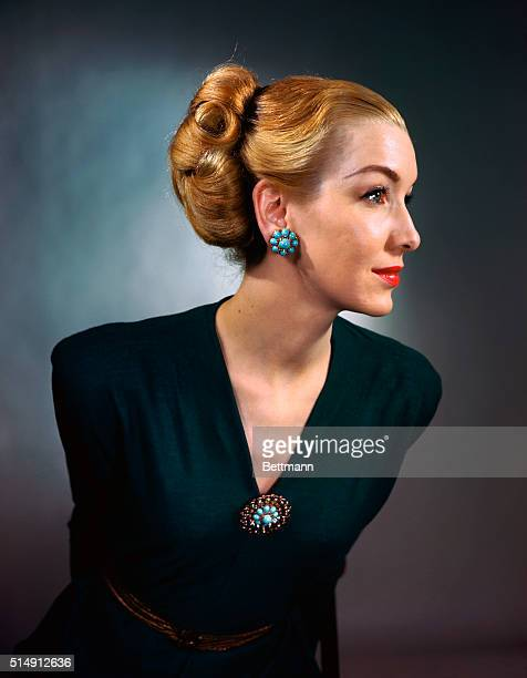 Lynn Engler the model wears lacy patterned filigree circular pin of sterling silver here with turquoise center which is the leading Spring color The...