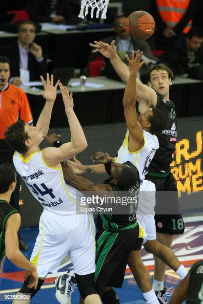 Lynn Greer #14 of Fenerbahce Ulker competes with and Omer Asik #24 of Fenerbahce Ulker competes with and Romain Sato #10 of Montepaschi Siena...