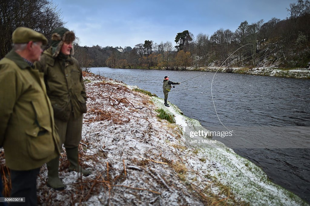Lynn Hannah fishes during the opening day of the salmon season on the River Spey on February 11, 2016 in Aberlour, Scotland. The annual opening day ceremony took place at Penny Bridge, with the traditional pouring of a bottle of Aberlour twelve year old single malt Scotch whisky into the river.