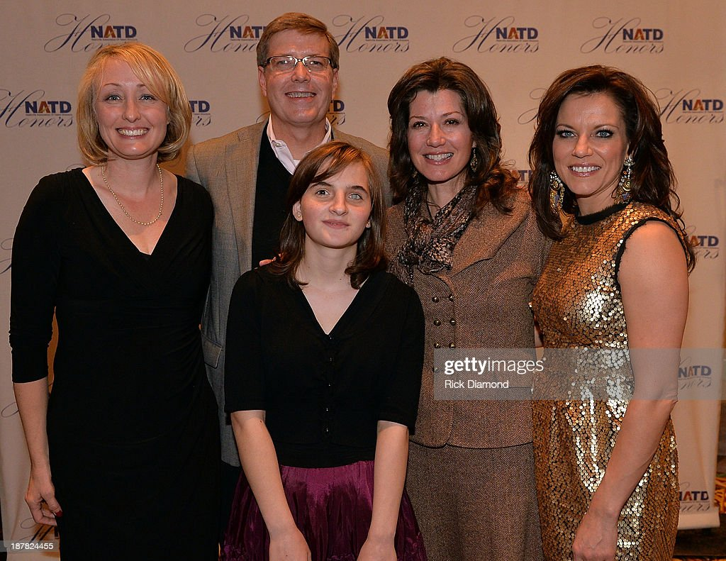 Lynn Hendrich, Steve Hendrich, Maria Morari, Singer/Songwriter Amy Grant and Honoree Singer/Songwriter Martina McBride. NATD presented $20,000 to Maria Morari, a blind orphan from Moldova, who was brought to the United States by Steve and Lynn Hendrich for a life-changing procedure by Dr. Ming Wang. His goal was to bring back 30 percent of the vision in her right eye and the surgery was very successful. Members of NATD heard her story and were prompted to present the check to Maria with the hopes she may remain in the United States. NATD honors is held at the Hermitage Hotel on November 12, 2013 in Nashville, Tennessee.