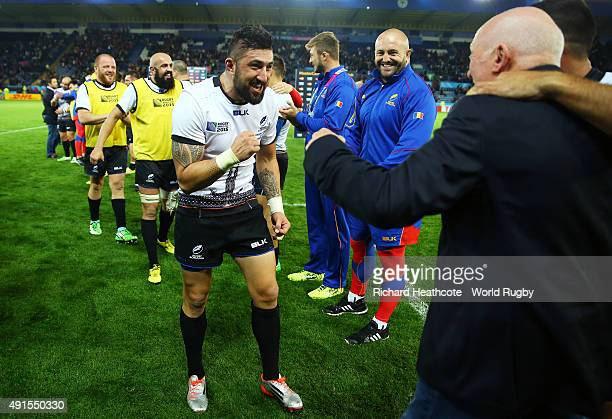 Lynn Howells Head Coach of Romania celebrates victory with Florin Vlaicu of Romania after the 2015 Rugby World Cup Pool D match between Canada and...