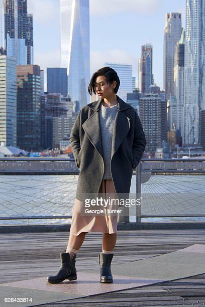 Lynn Kim Do seen wearing oversized grey coat with large collar by CMEO Collective oversized large knit grey ribbed sweater by Mini Market sheer peach...