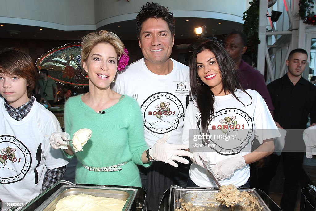 Lynn Martinez, Louis Aguirre and Adriana De Maura participate in 5th Annual Thanksgiving Feed A Friend at Bongos on November 22, 2012 in Miami, Florida.
