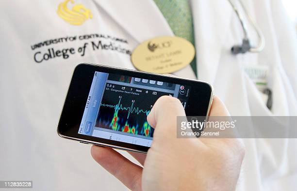 Lynn McGrath UCF medical student uses a medical app he downloaded to his iPod Touch October 11 2010 The app teaches heart sounds Starting this...