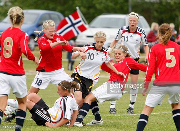Lynn Mester tries to find the way throgh the Norwegian defence during the U16 Nordic Cup match between Norway and Germany at the Hvolsvollur stadium...