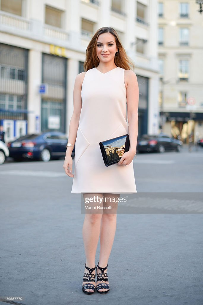 Lynn Samra poses wearing a Balenciaga dress and a Versace clutch after the Atelier Versace show at the Palais Brogniart on July 5 2015 in Paris France
