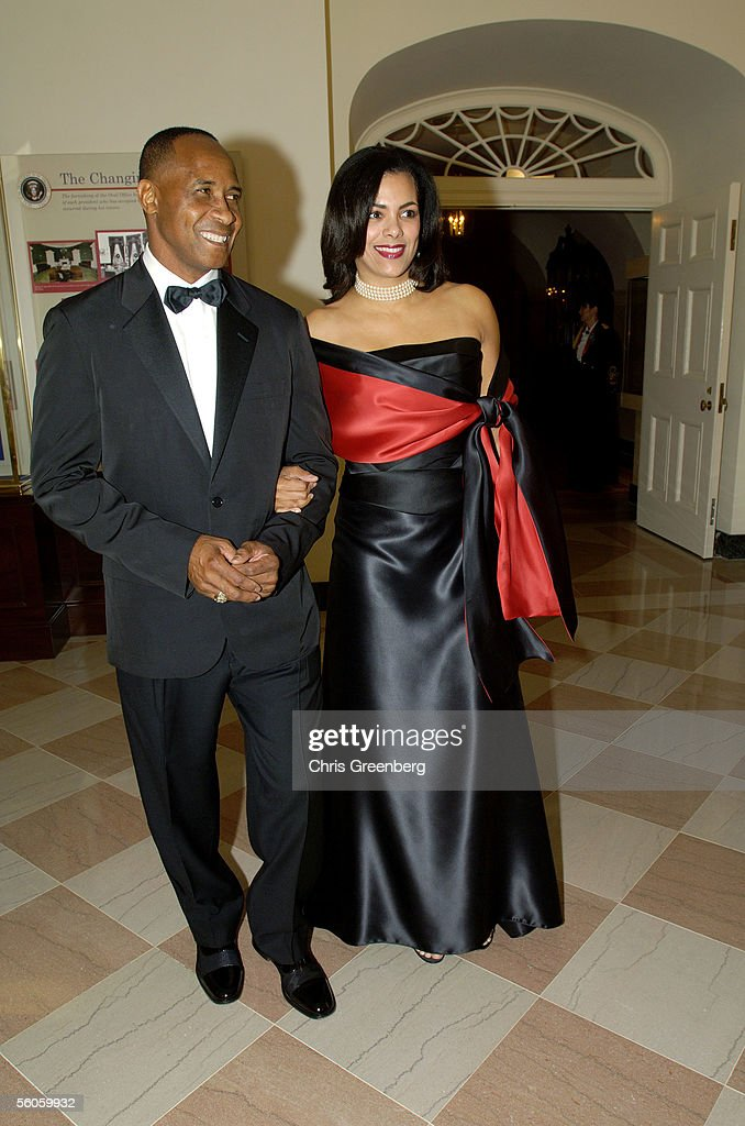Lynn Swann, ABC Sports collegiate football commentator, and his wife Charena pose on the way through the Booksellers room of the White House en route to a social dinner in honor of Prince Charles, Prince of Wales and Camilla, Duchess of Cornwall November 2, 2005. The dinner is hosted by U.S. President George W. Bush and the first lady.
