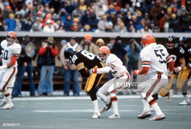 Lynn Swann of the Pittsburgh Steelers gets tackled by Scott Perry of the Cincinnati Bengals during an NFL football game December 2 1979 at Three...