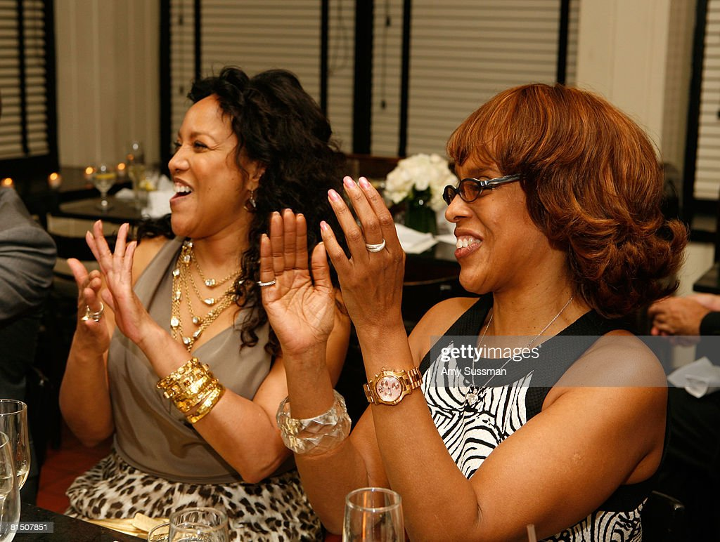 Lynn Whitfield (L) and Gayle King (R) listen to a toast at a celebration of Ruby Dee's style at Melba's restaurant on June 9, 2008 in New York City.
