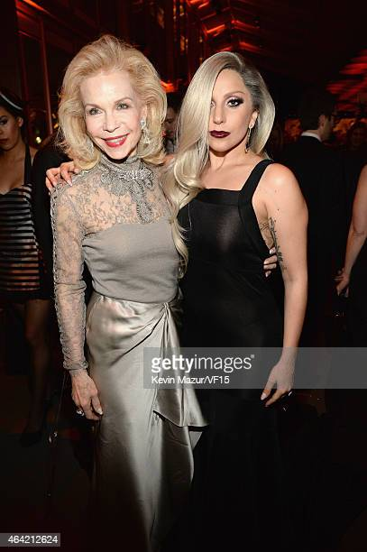 Lynn Wyatt and Lady Gaga attends the 2015 Vanity Fair Oscar Party hosted by Graydon Carter at the Wallis Annenberg Center for the Performing Arts on...