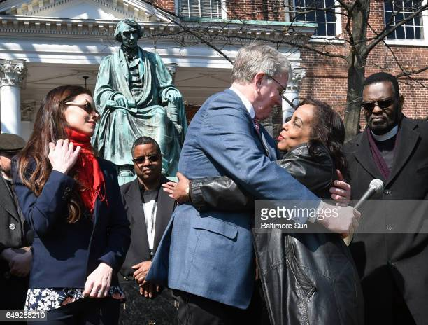 Lynne Jackson right great great granddaughter of Dred Scott hugs Charles Taney III a descendant of US Supreme Court Chief Justice Roger Taney after...