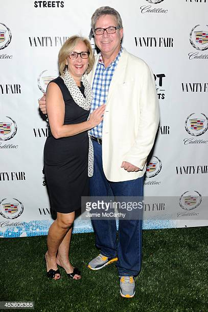 Lynne Richard and John Richard of the Adrienne Arsht Center for the Performing Arts attend Vanity Fair And Cadillac Toast The Artists Of Wynwood...