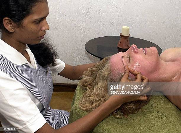 Lynne Sedgemore receives a facial massage with herbal medicinal oil at the Barberyn beach Ayurvedic resort at Weligama southern Sri Lanka 150 kms...