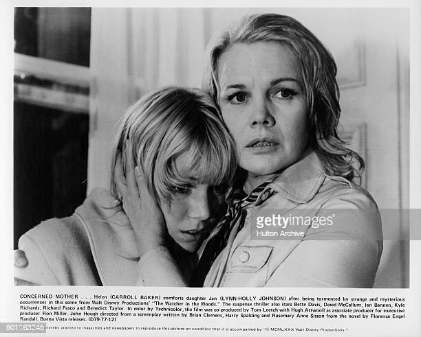 LynnHolly Johnson is held by Carroll Baker as she looks scared in a scene for the Walt Disney movie 'The Watcher in the Woods' circa 1979