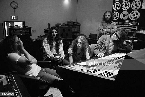 Lynyrd Skynyrd members Ronnie Van Zant Gary Rossington and Allen Collins work with producer Al Kooper on 'Pronounced Lynyrd Skynyrd' with an engineer...