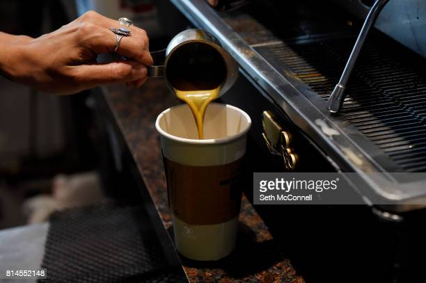Lynzie Blair pours espresso into a cup as she makes a beverage for a customer at Steamer's Coffeehouse on July 13 in Arvada Colorado Steamer's...