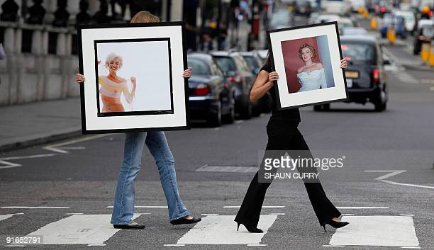 Lyon and Turnbull employees pose with two of the last photographs taken of Marilyn Monroe 'Marilyn Monroe in Stripe Scarf ' by Bert Stern and...