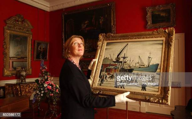 Lyon and Turnbull's Valerie Kyle holds a rare Lowry painting that is expected to fetch up to 200000 at auction