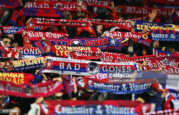 Lyon Fans celebrate victory by raising their scarves during the UEFA Champions League First KnockOut Second Leg match between Olympique Lyon and SV...