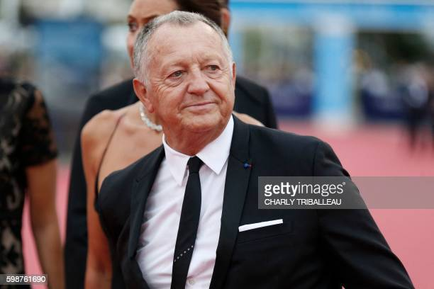 Lyon football club's president JeanMichel Aulas poses on the red carpet before the opening ceremony of the 42nd Deauville US Film Festival on...