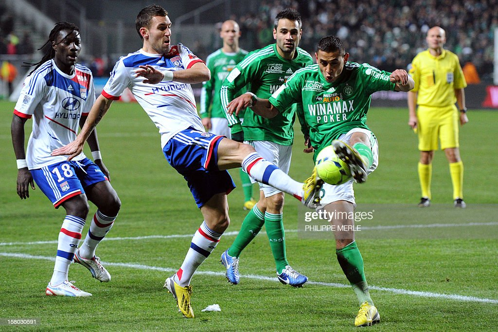 Lyon forward Anthony Reveillere (2nd L) fights for the ball with Saint-Etienne defender Faouzi Ghoulam on December 9, 2012 during a French L1 football match at the Geoffroy-Guichard stadium in the central city of Saint-Etienne. MERLE