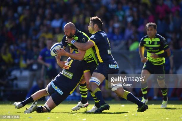 Lyon France 23 April 2017 Hayden Triggs of Leinster is tackled by Arthur Iturria left and Damien Chouly of ASM Clermont Auvergne during the European...