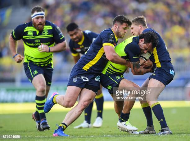 Lyon France 23 April 2017 Isa Nacewa of Leinster is tackled by Damien Penaud and David Strettle of ASM Clermont Auvergne during the European Rugby...