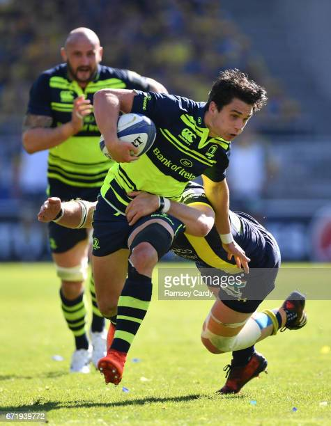 Lyon France 23 April 2017 Joey Carbery is tackled by Benjamin Kayser of ASM Clermont Auvergne during the European Rugby Champions Cup SemiFinal match...