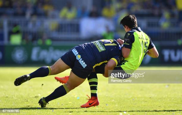 Lyon France 23 April 2017 Joey Carbery is tackled by Ludovic Radosavljevic of ASM Clermont Auvergne during the European Rugby Champions Cup SemiFinal...