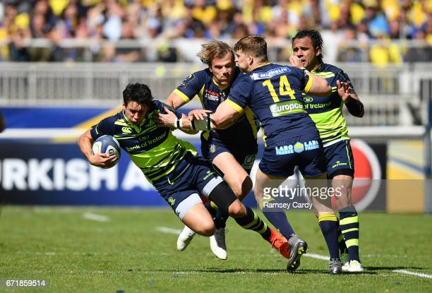 Lyon France 23 April 2017 Joey Carbery of Leinster is tackled by Aurélien Rougerie of ASM Clermont Auvergne during the European Rugby Champions Cup...
