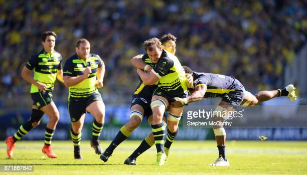 Lyon France 23 April 2017 Rhys Ruddock of Leinster is tackled by Damien Chouly left and Peceli Yato of ASM Clermont Auvergne during the European...